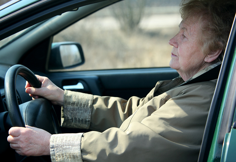 An older woman driving her car